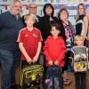 Le Sapin du Petit Bonheur distribue des sacs d'école