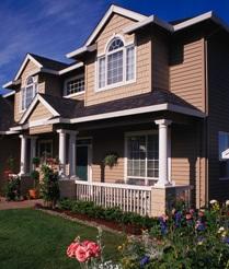 Immobilier-maison-facade-fleurs-Photo-CPA-publiee-par-INFOSuroit-com_