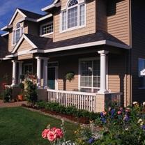Immobilier-maison-facade-fleurs-miniature-Photo-CPA-publiee-par-INFOSuroit-com_