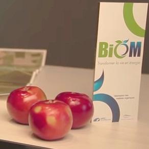 Complexe BioM pommes et logo Image courtoisie