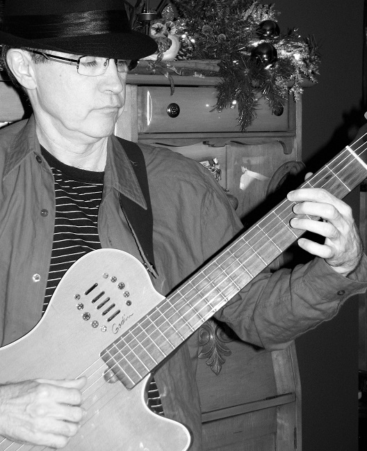 guitariste-michelmorissette-pour-album-noel-winter_soltice_d_hiver-photo-courtoisie-musee-regional-vs